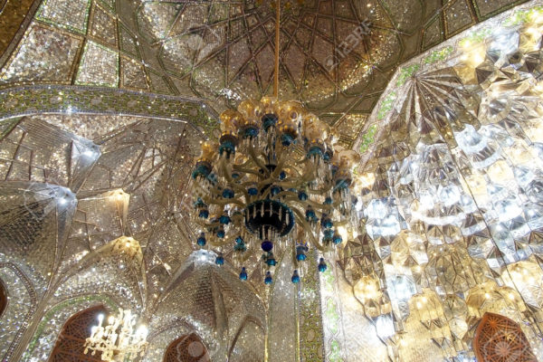 Architecture details in the mirrors room at the Shah Cheragh Mosque, Shiraz, Iran. The place is a funeral monument and mosque, housing the tombs of brothers Ahmad and Muhammad, sons of Musa al Khadim and brothers of Ali arl Ridha. The two took refuge during the Abbassid persecution of Shia Muslim. The tombs became the celebrate pilgrimage centres in 14th century when Queen Tashi Kathun erected a mosque and theological school in the vicinity.